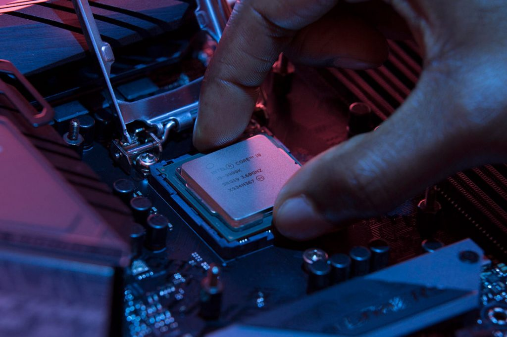 close up of a hand installing an Intel CPU